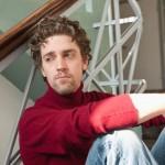 Mid adult man sitting on stairway